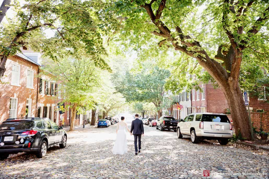 September wedding portrait of bride and groom in Old Town Alexandria shot by photojournalistic wedding photographer Kyo Morishima