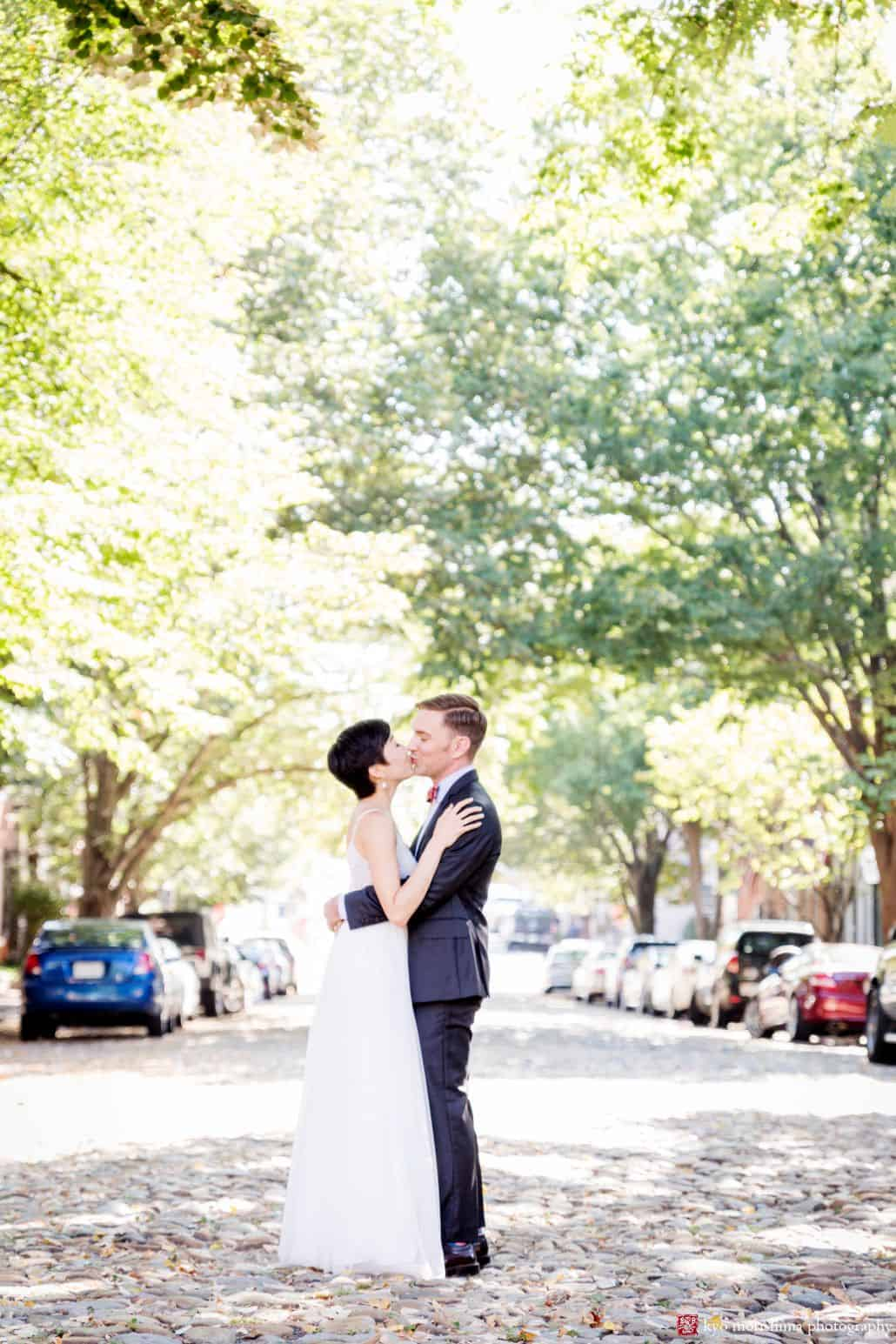 Bride and groom kiss on September morning before their wedding in Old Town Alexandria, by DC wedding photographer Kyo Morishima