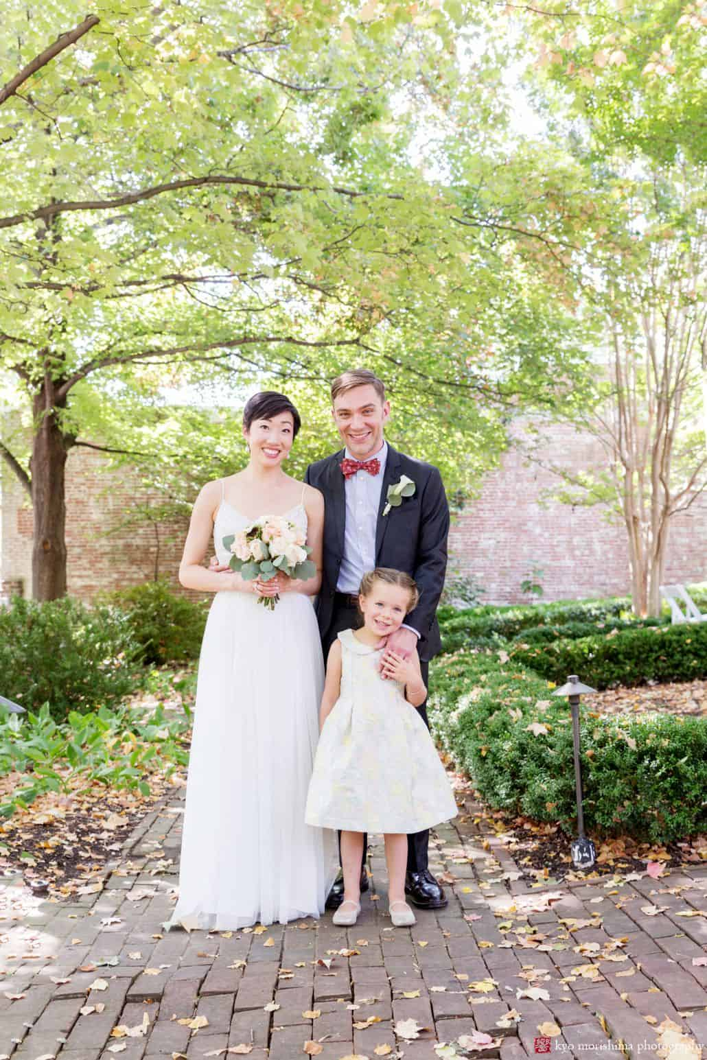 Bride groom and daughter casual and relaxed wedding portrait in Old Town Alexandria