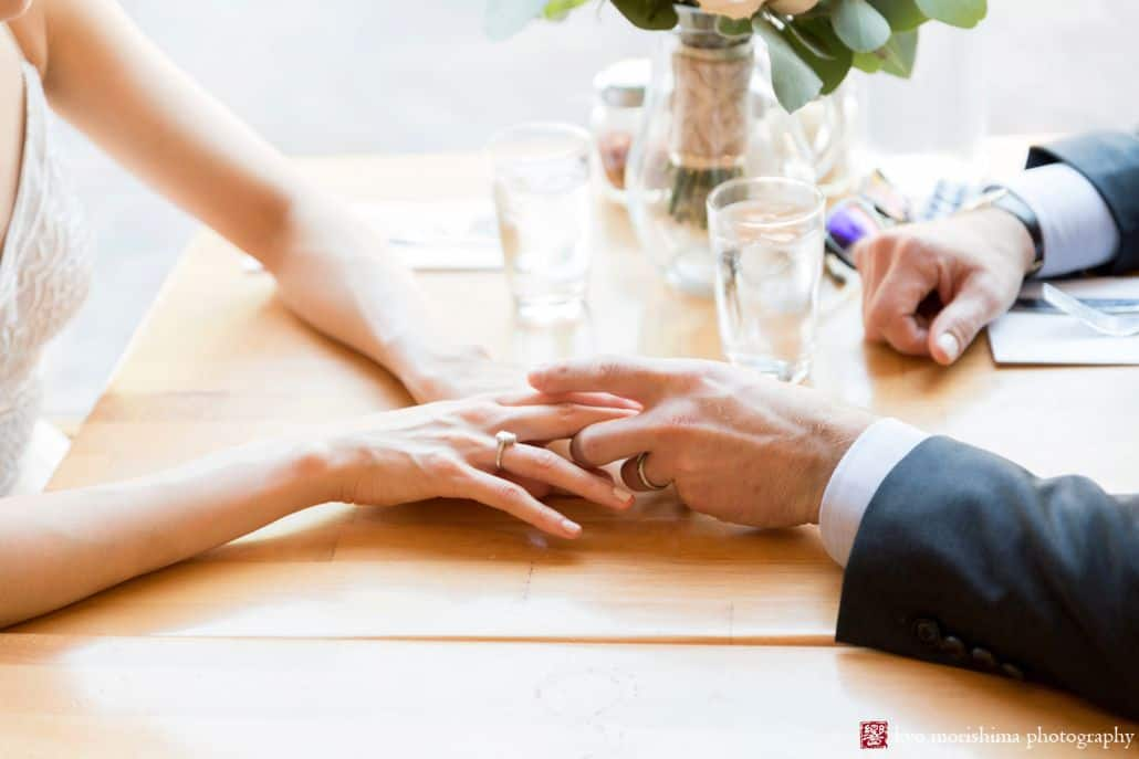 Bride and groom hold hands at restaurant in Old Town Alexandria