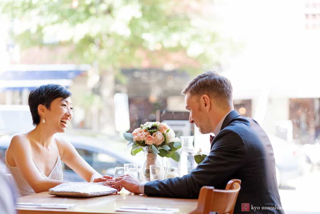 Bride and groom relax at pizza joint in Old Town Alexandria before going to their wedding reception; candid photo by DC photographer Kyo Morishima
