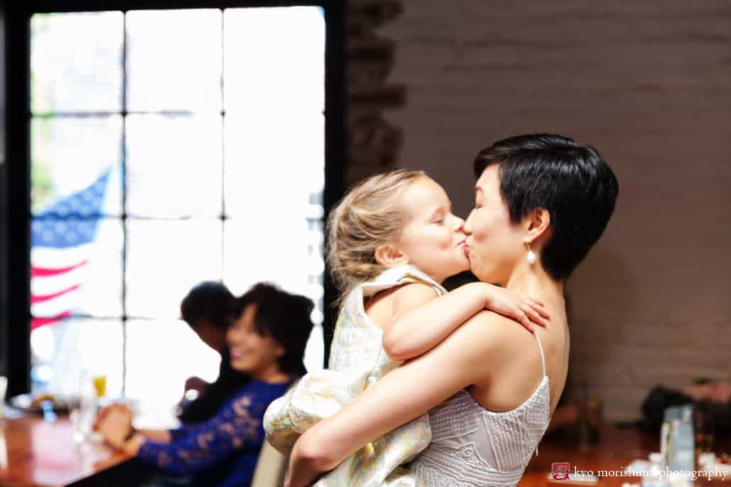 Little girl kisses Asian bride at multicultural wedding at Virtue Feed and Grain in Old Town Alexandria