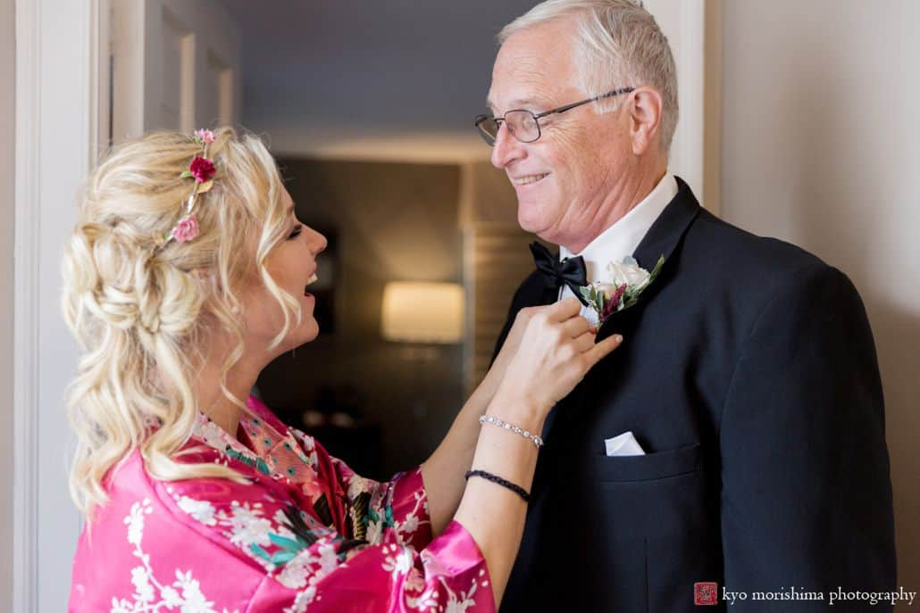 Bridesmaid and father of the bride get ready for the wedding at the Chauncey Conference Center's Laurie House B&B in Princeton, NJ.