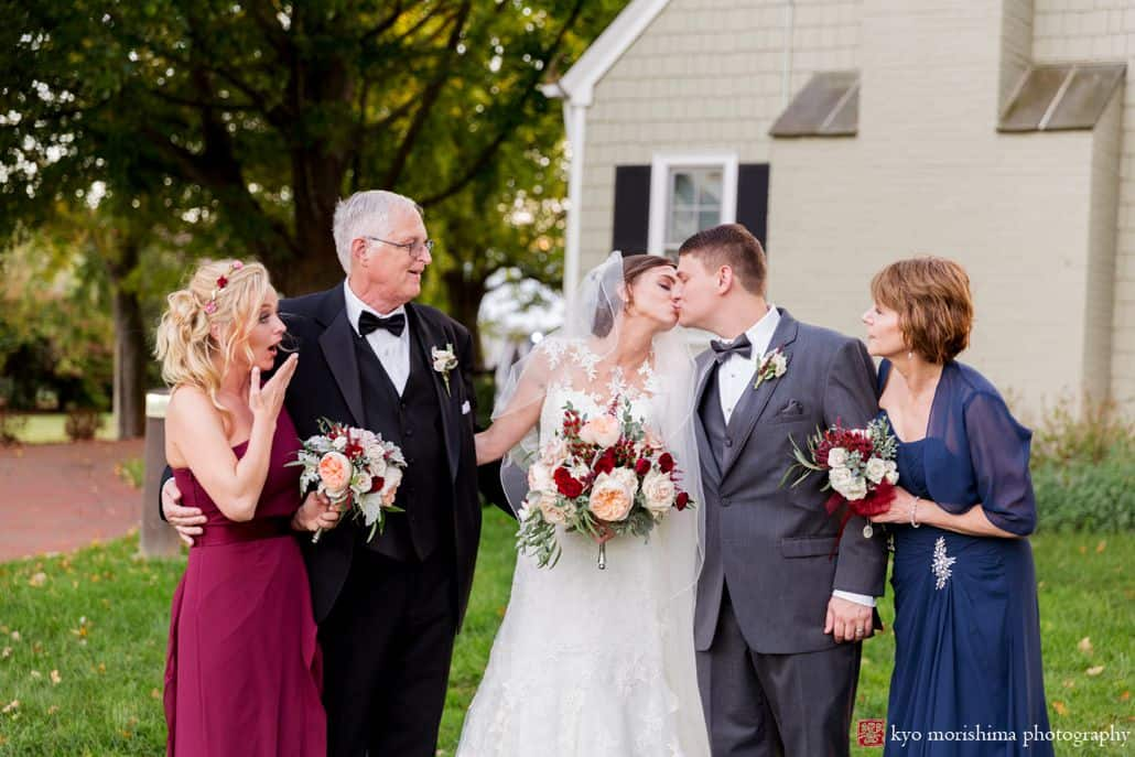 Fun wedding portrait at Laurie House as parents and bridesmaid react to bride and groom kiss, photographed by Princeton wedding photographer Kyo Morishima