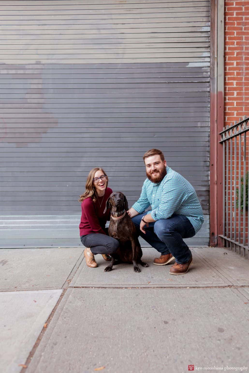 Park Slope engagement picture: couple poses with Weimaraner dog