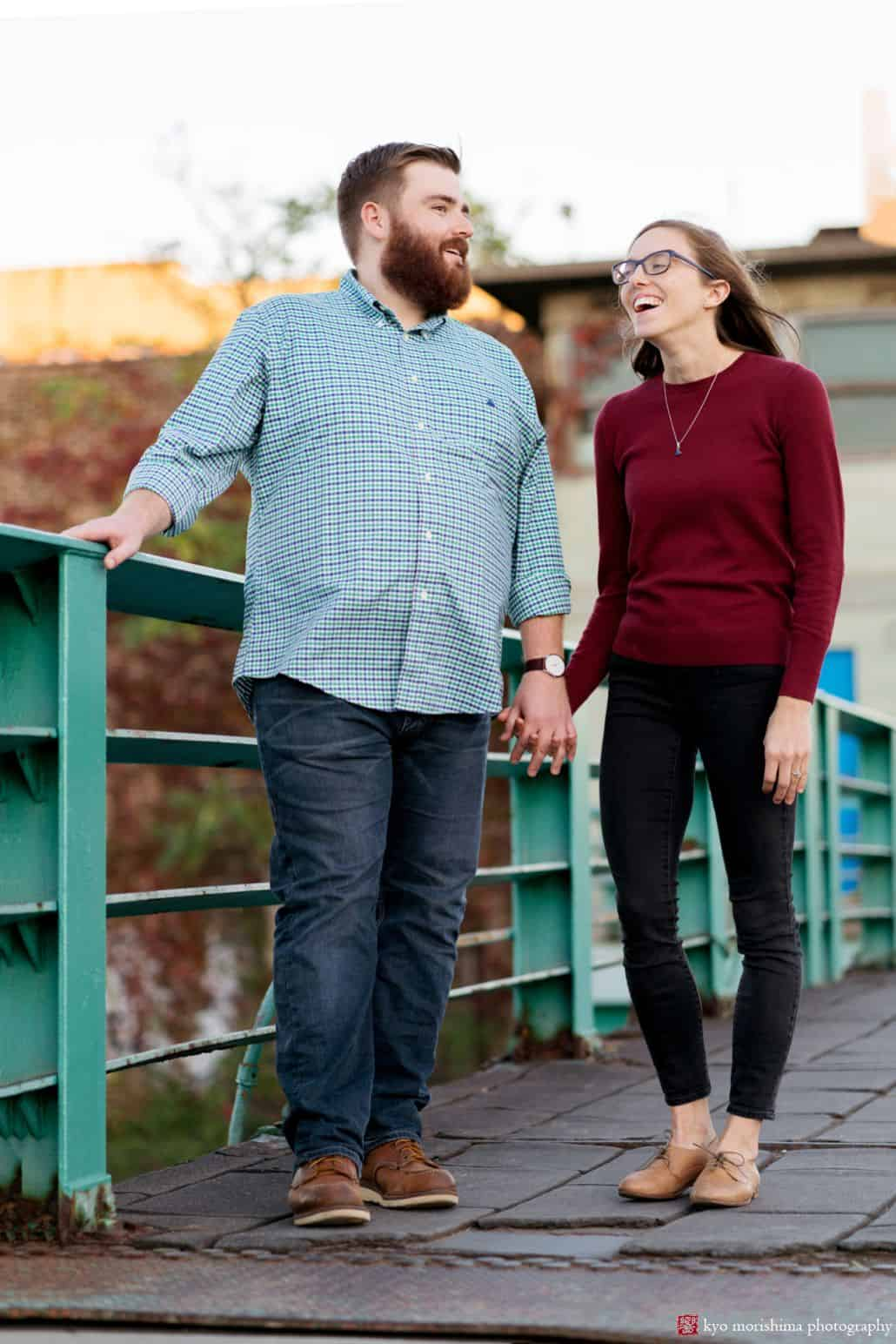 Couple laughs on bride overlooking Gowanus Canal, by Brooklyn photographer Kyo Morishima