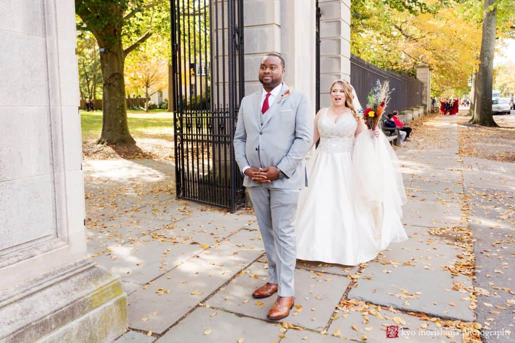 Fall first look on Nassau Street in front of Princeton University gates at the beginning of October wedding