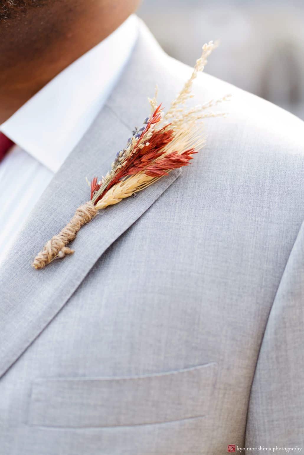 Fall grass wedding boutonniere on light grey suit