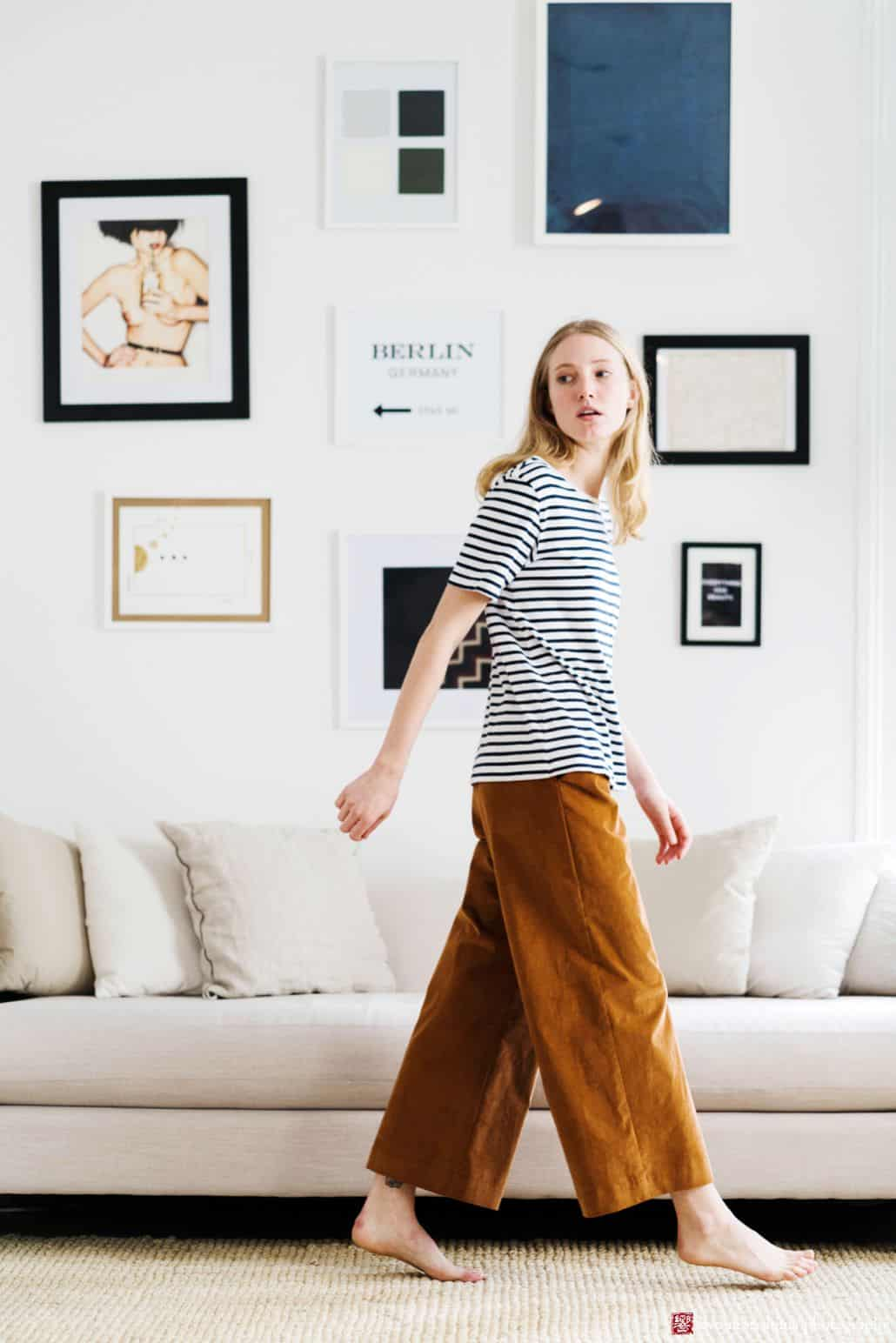 Lookbook photography for Princeton fashion label Semi Gloss NYC winter 2018 collection: black and white striped t-shirt with rust colored velvet pants