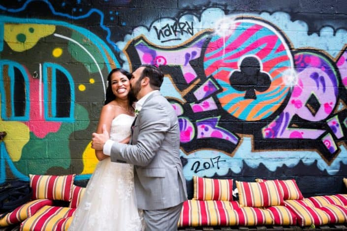 Graffiti wedding photo: Brooklyn portrait at Electric Anvil Tattoo