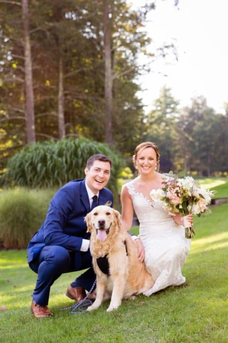 Wedding portrait with dog: bride and groom with golden retriever at Woodloch Pines Resort wedding