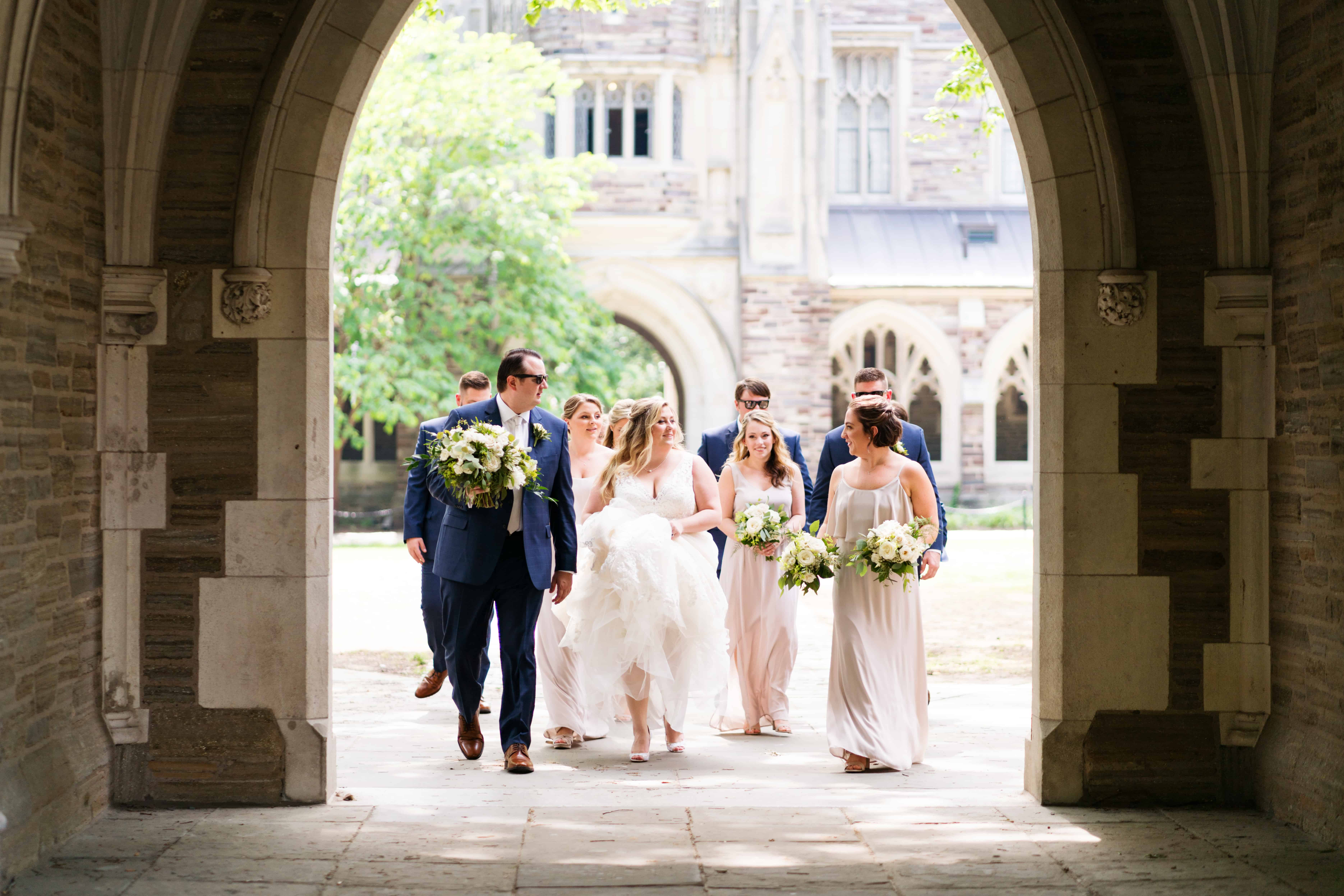 Classic Princeton University wedding photo as wedding party enters campus