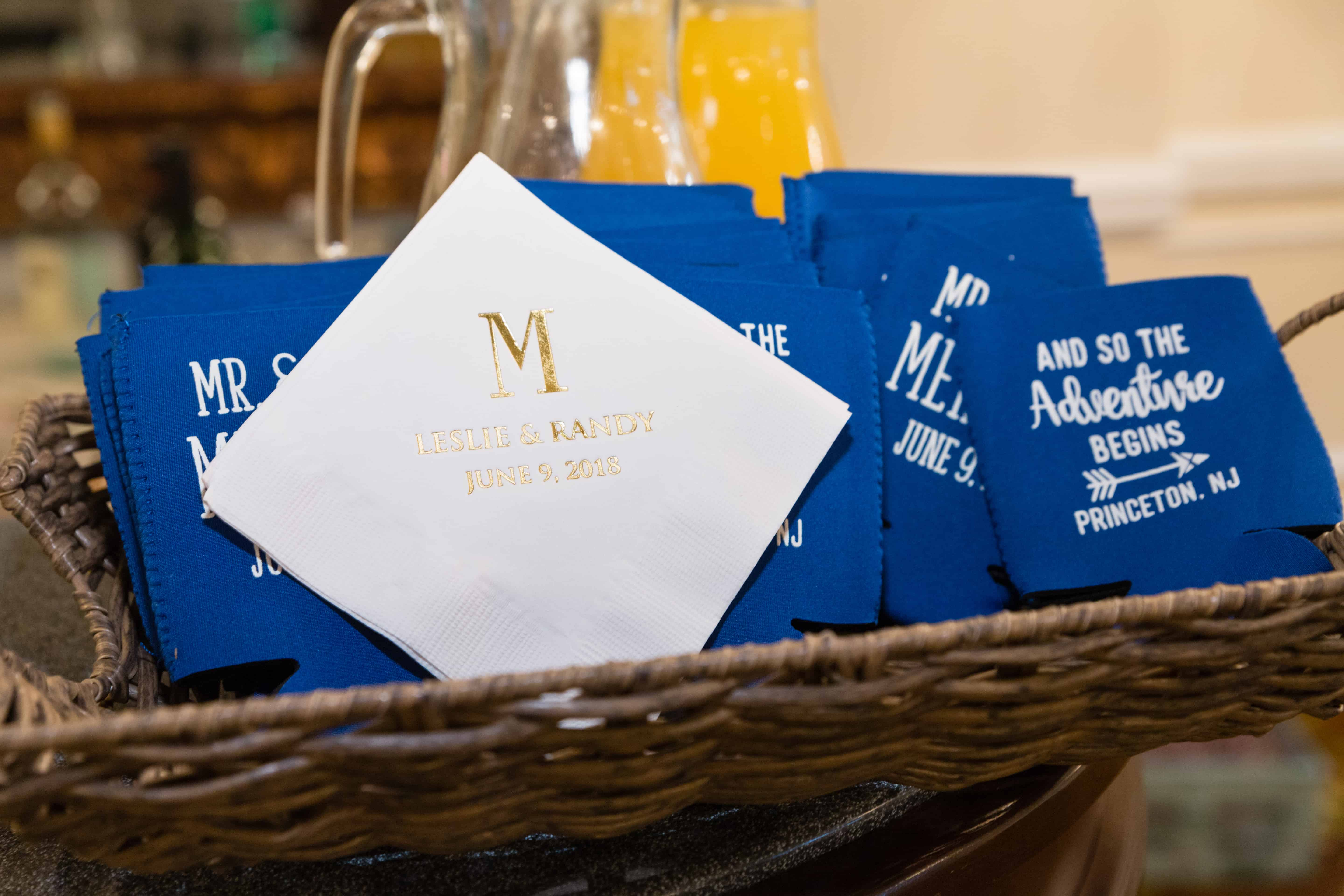 Monogrammed napkin and beer can cooler wedding favors