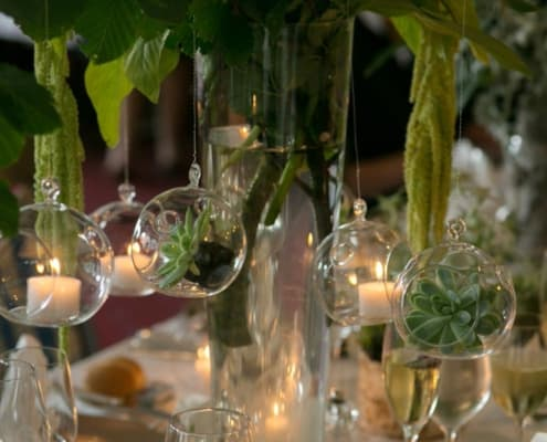Succulents and moss hanging from branches as table centerpiece wedding decor idea: simple and inexpensive