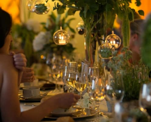 Twinkle lights and succulents suspended from branches in glass globes: easy, simple, and beautiful wedding decor idea